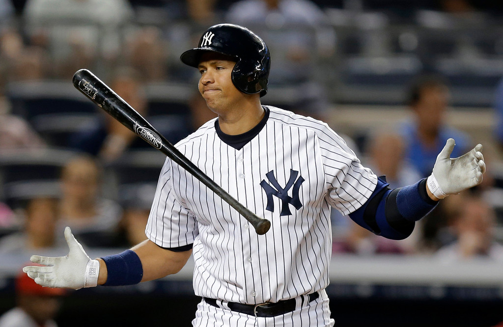 . New York Yankees\' Alex Rodriguez reacts after striking out in the seventh inning of a baseball game against the Los Angeles Angels, Tuesday, Aug. 13, 2013, in New York. (AP Photo/Kathy Willens, File)