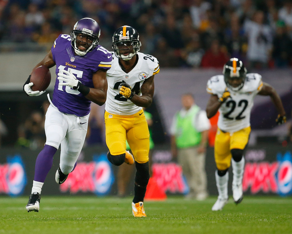 . Pittsburgh Steelers Ike Taylor (24) and Steelers William Gay (22) chase Minnesota Vikings wide receiver Greg Jennings as he runs for 70-yard touchdown after a pass from quarterback Matt Cassel during their NFL football game against the Pittsburgh Steelers at Wembley Stadium, London, Sunday,Sept. 29, 2013.  (AP Photo/Matt Dunham)