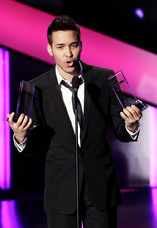 . Singer Prince Royce receives the Male Artist Album of the Year, at the Latin Billboard Awards in Coral Gables, Fla., Thursday April 25, 2013. (AP Photo/Alan Diaz)