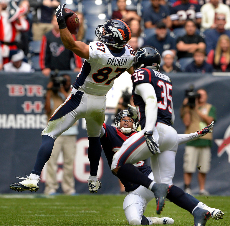 . Wide receiver Eric Decker #87 of the Denver Broncos can\'t hold onto this pass against  the Houston Texans at Reliant Stadium December 22, 2013 Houston, Texas. (Photo By Joe Amon/The Denver Post)