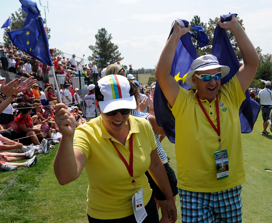 . PARKER, CO - Aug.17: Team Europe fans celebrate on the 18th green. The 2013 Solheim Cup takes place at the Colorado Golf Club with the USA taking on Europe in the Saturday morning Foursomes Match. (Photo By Kathryn Scott Osler/The Denver Post)