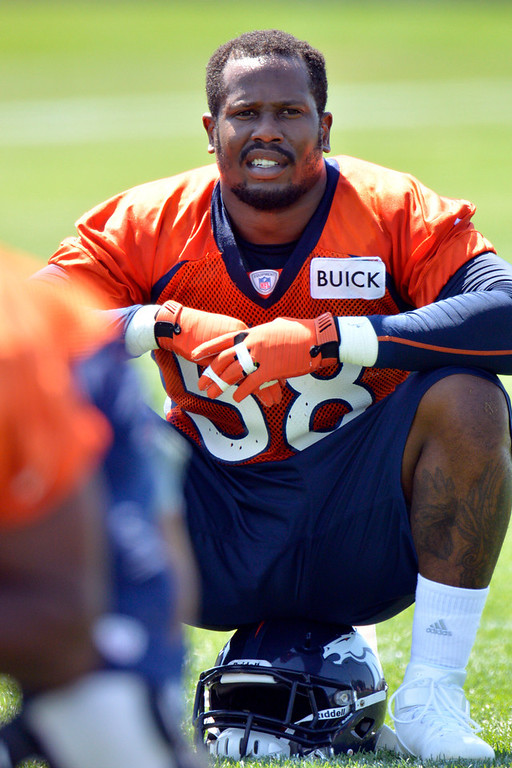 . Denver Broncos :B Von Miller (58) takes a break as he sits on his helmet during training camp July 26, 2013 at Dove Valley. (Photo By John Leyba/The Denver Post)