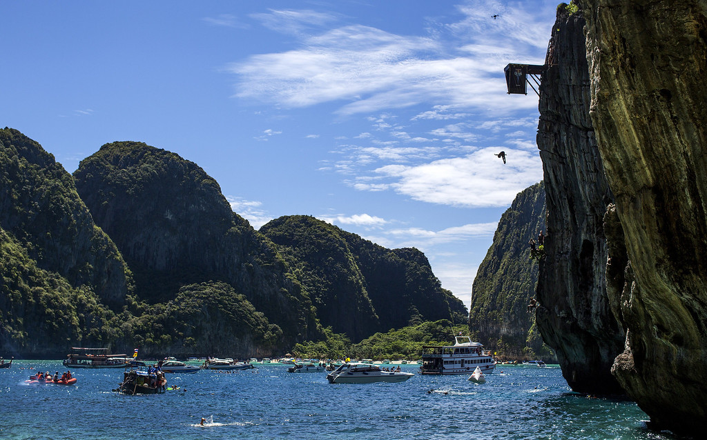 . In this handout image provided by Red Bull, Gary Hunt of the UK dives from the 27 meter platform at Maya Bay in the Andaman Sea during the final stop of the 2013 Red Bull Cliff Diving World Series on October 22, 2013 at Phi Phi Island, Thailand. (Photo by Romina Amato/Red Bull via Getty Images)