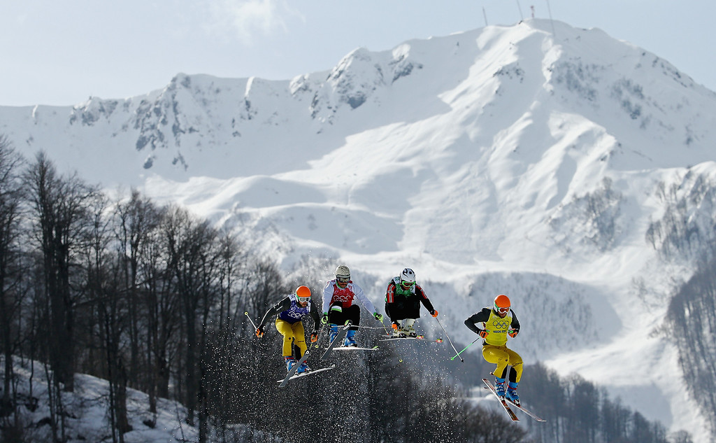 . Andreas Schauer (R) of Germany, Didrik Bastian Juell (2ndR) of Norway, Filip Flisar of Slovenia and Florian Eigler (L) of Germany compete during the Freestyle Skiing Men\'s Ski Cross Quarter Finals on day 13 of the 2014 Sochi Winter Olympic at Rosa Khutor Extreme Park on February 20, 2014 in Sochi, Russia.  (Photo by Al Bello/Getty Images)