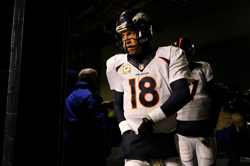 . Quarterback Peyton Manning #18 of the Denver Broncos heading to the field for their game vs the New England Patriots at Gillette Stadium in Foxborough MA, November 24, 2013 Denver. (Photo By Joe Amon/The Denver Post)