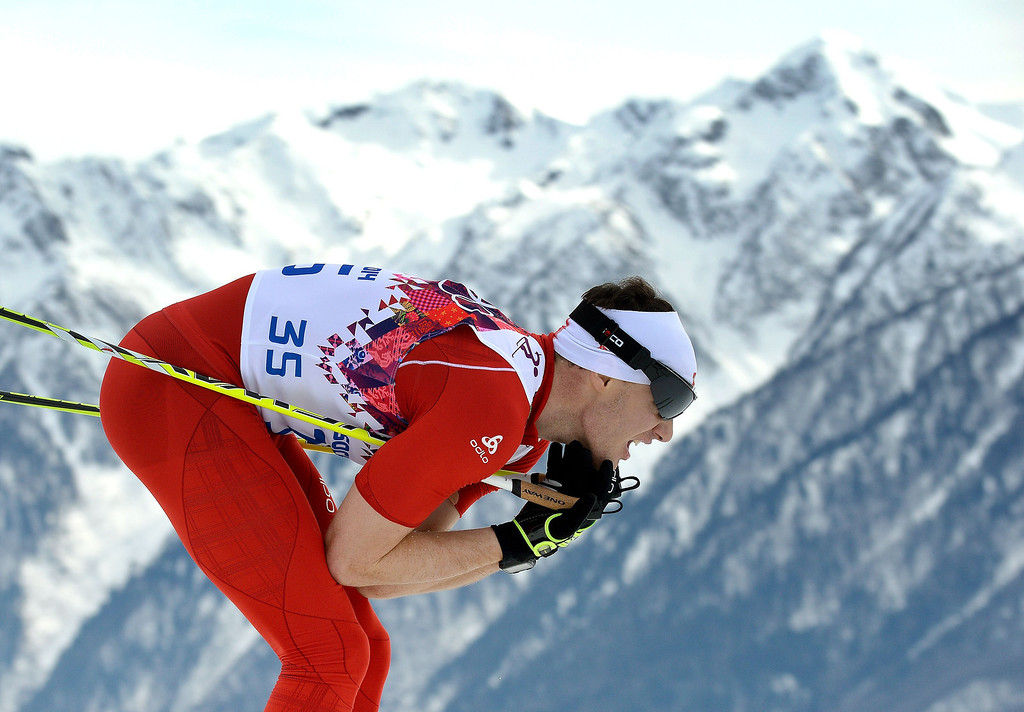 . Switzerland\'s Dario Cologna competes in the Men\'s Cross-Country Skiing 15km Classic at the Laura Cross-Country Ski and Biathlon Center during the Sochi Winter Olympics on February 14, 2014. ALBERTO PIZZOLI/AFP/Getty Images