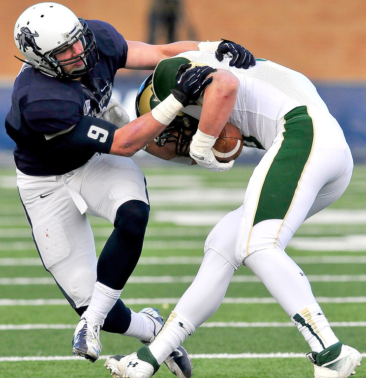 . Utah State\'s Kyler Fackrell (9) makes a tackle on Colorado State\'s Crockett Gillmore (10) during an NCAA college football game, Saturday, Nov. 23, 2013, in Logan, Utah. Utah State won 13-0. (AP Photo/Herald Journal, John Zsiray)