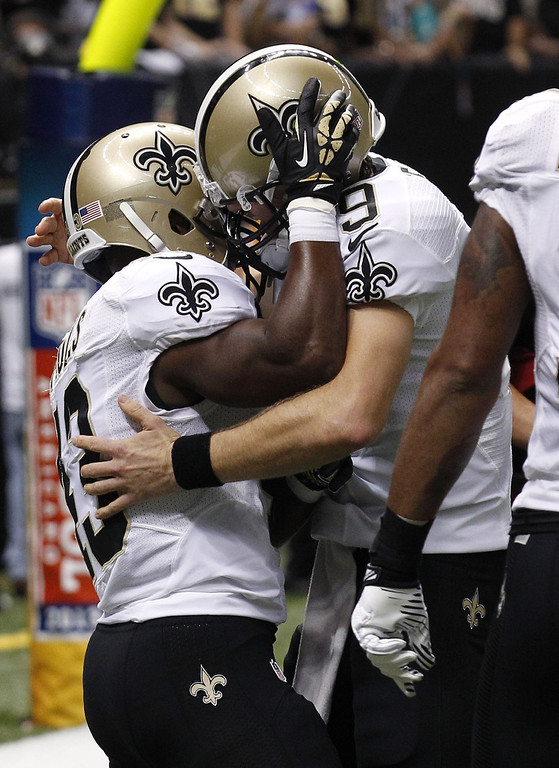 . New Orleans Saints running back Darren Sproles (43) celebrates his touchdown reception with quarterback Drew Brees (9) in the first half of an NFL football game in New Orleans, Monday, Sept. 30, 2013. (AP Photo/Bill Haber)