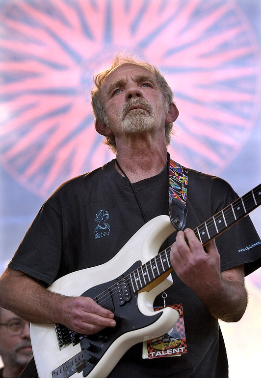 ". In this June 5, 2004 file photo, singer-songwriter J.J. Cale plays during the Eric Clapton Crossroads Guitar Festival in Dallas. Cale, whose best-known songs became hits for Eric Clapton with ""After Midnight\"" and Lynyrd Skynyrd with \""Call Me the Breeze,\"" died July 26, 2013. He was 74. (AP Photo/Tony Gutierrez)"