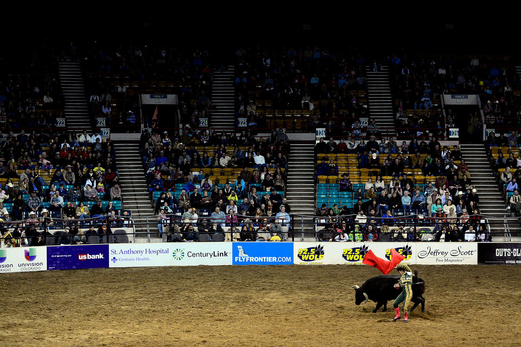 . Matador Alfredo Gutierrez maneuvers around the bull during National Western Stock Show\'s Mexican Rodeo Extravaganza at the Denver Coliseum on Sunday, Jan. 13, 2013. AAron Ontiveroz, The Denver Post