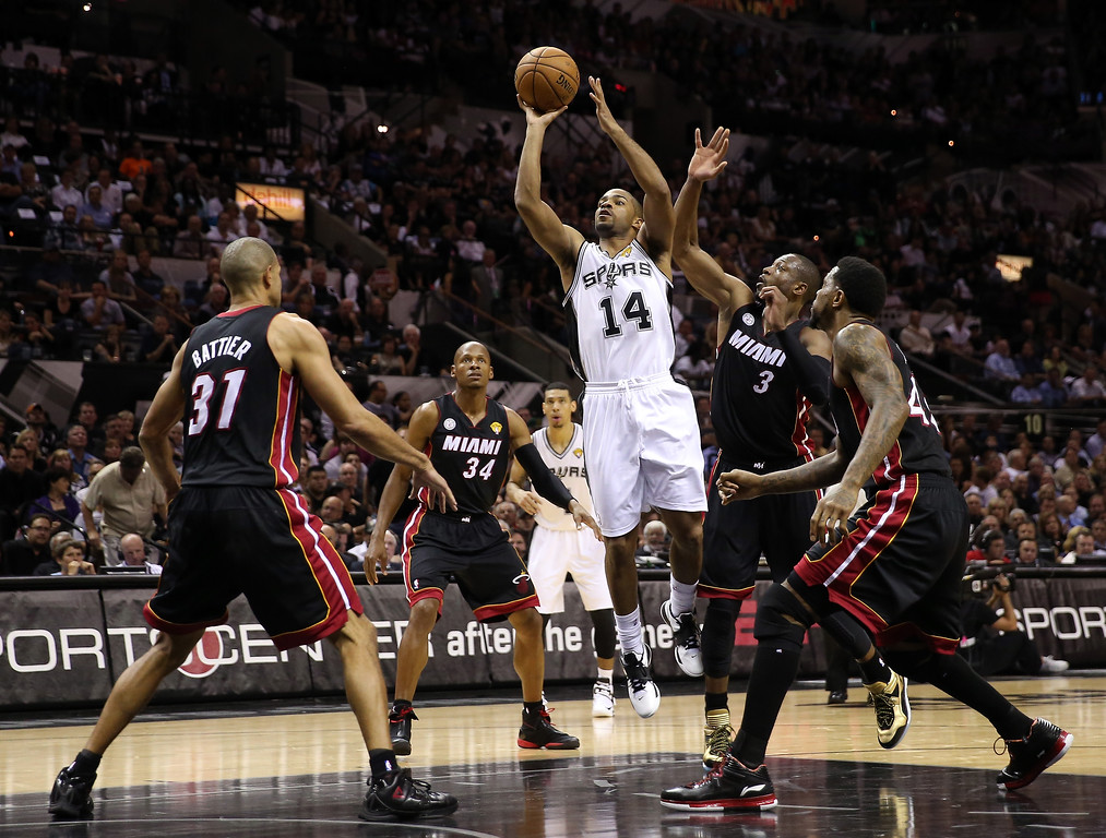 . Gary Neal #14 of the San Antonio Spurs shoots over Shane Battier #31 of the Miami Heat in the first half during Game Four of the 2013 NBA Finals at the AT&T Center on June 13, 2013 in San Antonio, Texas.  (Photo by Christian Petersen/Getty Images)