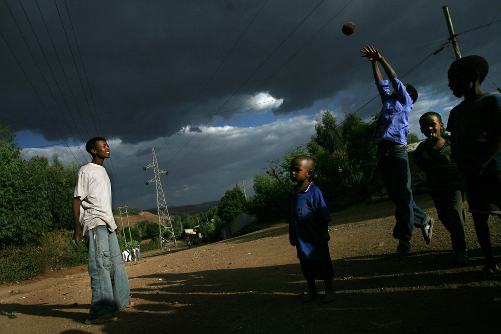 . GONDAR, ETHIOPIA - APRIL 28: Ethiopian Jewish boys play with a ball on April 28, 2007 in Gondar in northern Ethiopia. Some 2,500 Ethiopians of Jewish origin from this province remain in the East African country as Israel slowly brings them over, a few dozen at a time, on commercial flights. Since 1984, more than 73,000 Ethiopian Jews have been settled in Israel. (Photo by Uriel Sinai/Getty Images)