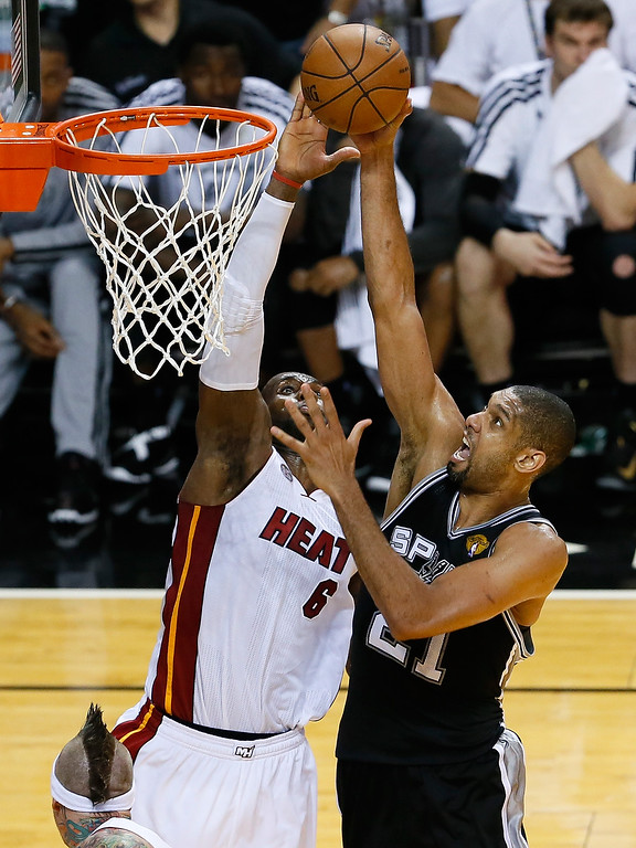. Tim Duncan #21 of the San Antonio Spurs has his shot blocked by LeBron James #6 of the Miami Heat in the fourth quarter during Game Six of the 2013 NBA Finals at AmericanAirlines Arena on June 18, 2013 in Miami, Florida.  (Photo by Kevin C. Cox/Getty Images)
