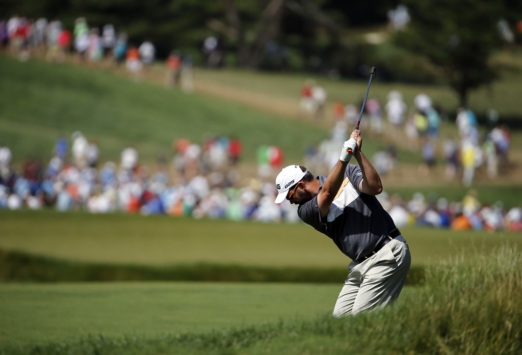 . Edward Loar of the United States hits his second shot on the eighth hole during Round Three of the 113th U.S. Open at Merion Golf Club on June 15, 2013 in Ardmore, Pennsylvania.  (Photo by Rob Carr/Getty Images)