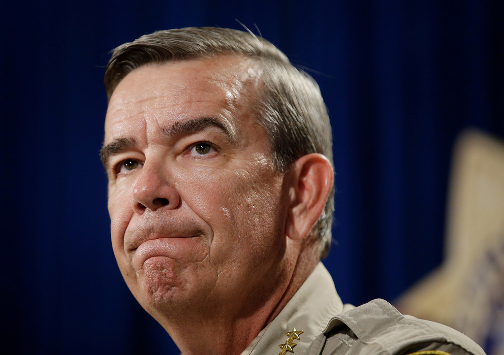 . Sheriff Doug Gillespie speaks at a news conference on the shooting of two Las Vegas Metropolitan Police Department officers Sunday, June 8, 2014 in Las Vegas. (AP Photo/John Locher)
