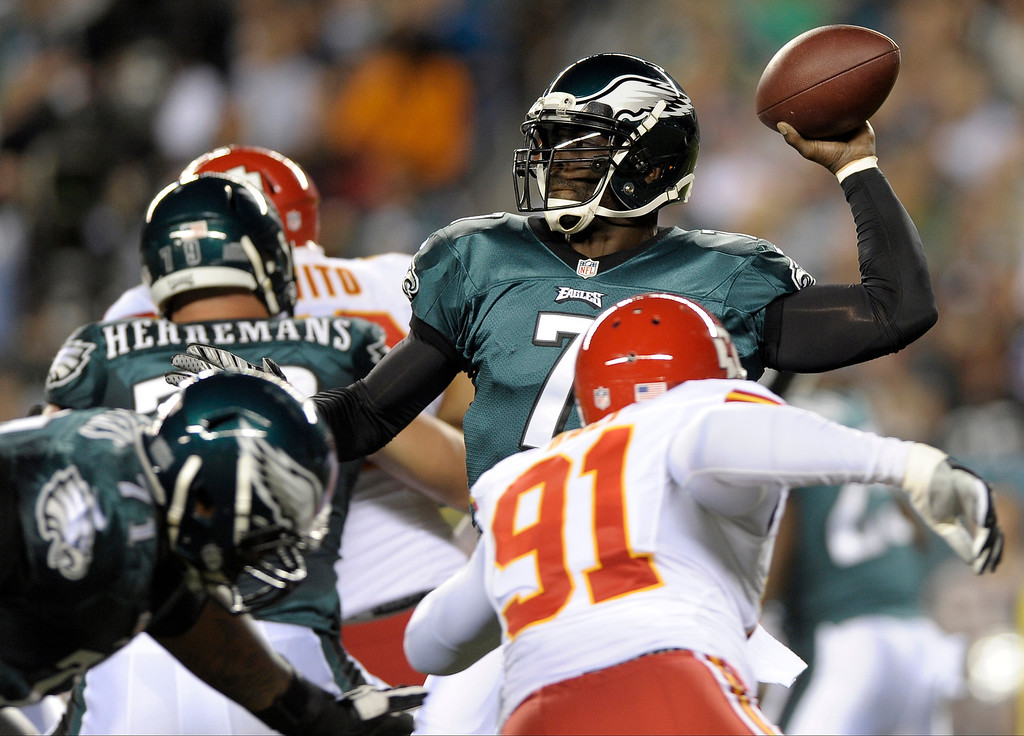 . Philadelphia Eagles quarterback Michael Vick passes during the first half of an NFL football game against the Kansas City Chiefs, Thursday, Sept. 19, 2013, in Philadelphia. (AP Photo/Michael Perez)