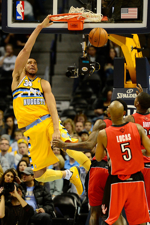 . Denver Nuggets center JaVale McGee (34) dunks against the Toronto Raptors during the second half of the Nuggets\' 113-110 win at the Pepsi Center on Monday, December 3, 2012. AAron Ontiveroz, The Denver Post