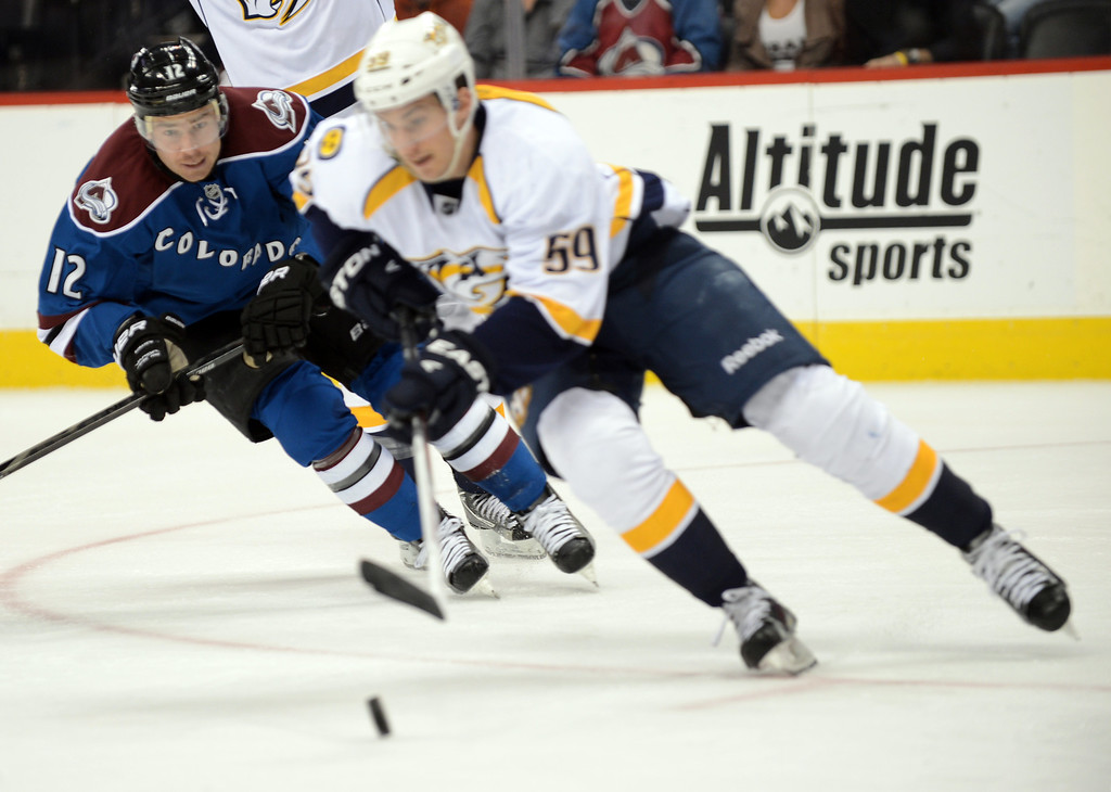 . Chuck Kobasew of Colorado Avalanche (#12), left, is defending Roman Josi of Nashville Predators (59) in the 1st period of the game at Pepsi Center. Denver, Colorado. March 30, 2013. (Photo By Hyoung Chang/The Denver Post)