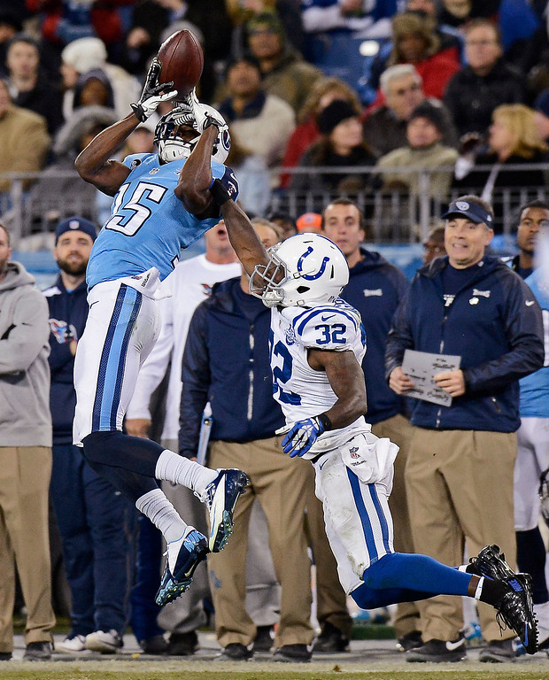 . Indianapolis Colts cornerback Cassius Vaughn (32) breaks up a pass intended for Tennessee Titans wide receiver Justin Hunter (15) in the fourth quarter of an NFL football game Thursday, Nov. 14, 2013, in Nashville, Tenn. (AP Photo/Mark Zaleski)