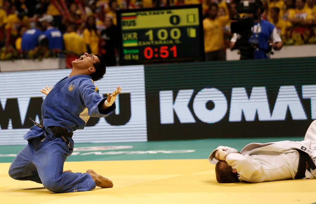 . Georgii Zantaraia from Ukraine, left, celebrates defeating Nijat  Shikhalizada from Azerbaijan at their men\'s - 66 kg match at the World Judo Championships in Rio de Janeiro, Brazil, Tuesday, Aug. 27, 2013. Zantaraia defeated Shikhalizada and won the bronze. (AP Photo/Silvia Izquierdo)