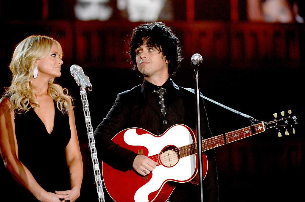 . Musicians Miranda Lambert and Billie Joe Armstrong perform onstage during the 56th GRAMMY Awards at Staples Center on January 26, 2014 in Los Angeles, California.  (Photo by Kevork Djansezian/Getty Images)