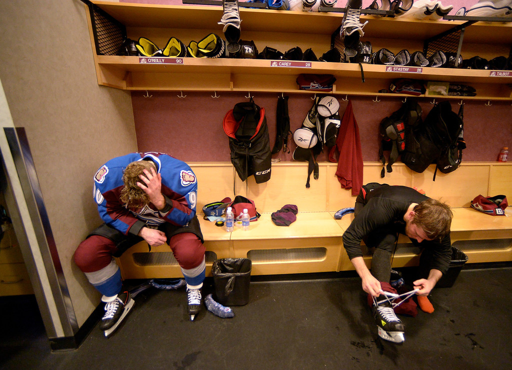 . Colorado Avalanche center Ryan O\'Reilly (90) sits at his locker next to Colorado Avalanche center Paul Stastny (26) after being defeated by the Minnesota Wild 5 to 4 in overtime. (Photo by John Leyba/The Denver Post)