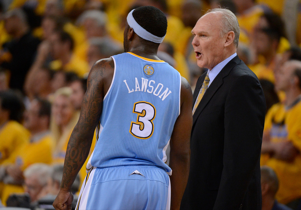 . George Karl of the Denver Nuggets talks with Ty Lawson (3) of the Denver Nuggets late in the fourth quarter in Game 6 of the first round NBA Playoffs May 2, 2013 at Oracle Arena. (Photo By John Leyba/The Denver Post)
