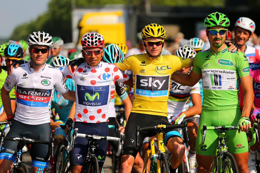 . Winner of the 2013 Tour de France, Chris Froome of Great Britain and SKY Procycling (2nd R) celebrates alongside second placed best young rider and King of the Mountain Nairo Quintana (2nd L) of Colombia and Movistar Team, winner of the Green Jersey Points Classification Peter Sagan (R) of Slovakia and Cannondale and winner of the Best Young Rider Jersey Andrew Talansky of the United States and Garmin Sharp during the twenty first and final stage of the 2013 Tour de France, a processional 133.5KM road stage ending in an evening race around the Champs-Elysees, on July 21, 2013 in Paris, France.  (Photo by Bryn Lennon/Getty Images)