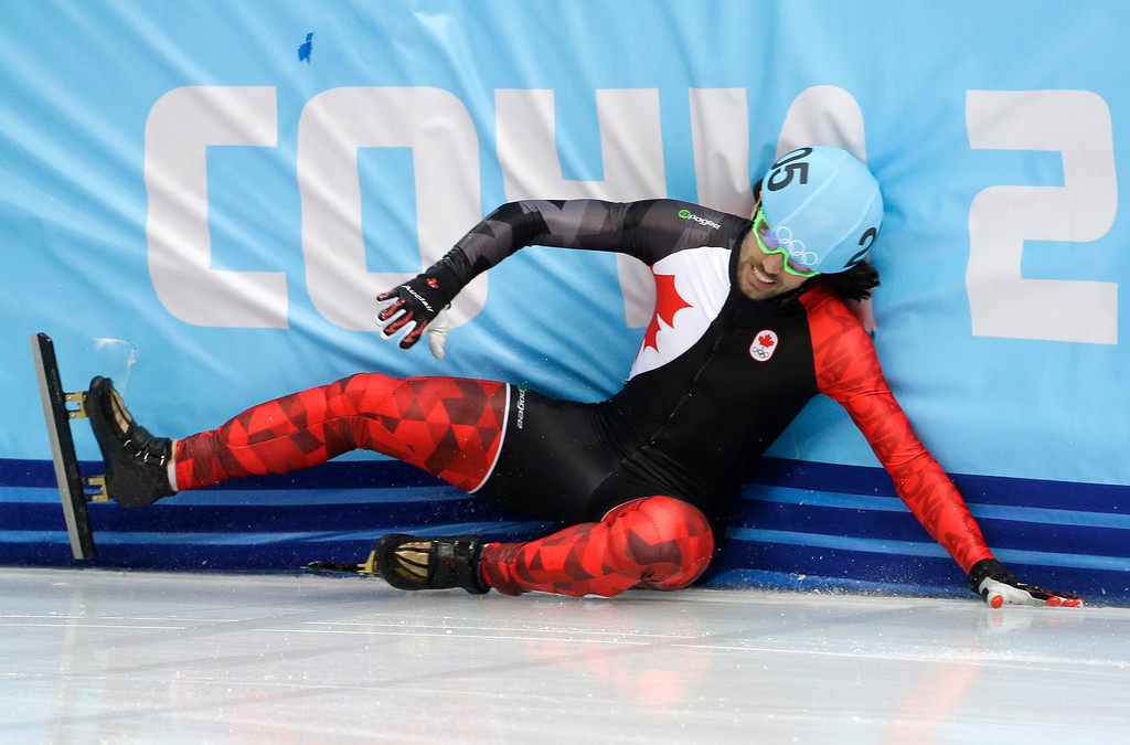 . Charles Hamelin of Canada crashes out in a men\'s 500m short track speedskating heat at the Iceberg Skating Palace during the 2014 Winter Olympics, Tuesday, Feb. 18, 2014, in Sochi, Russia. (AP Photo/David J. Phillip )