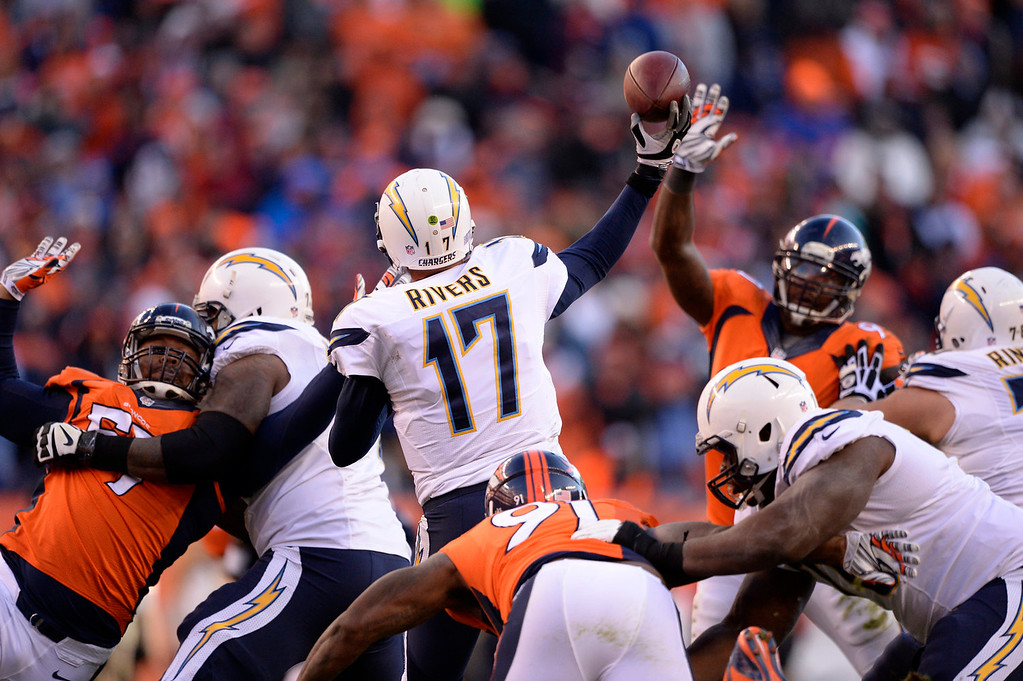 . San Diego Chargers quarterback Philip Rivers (17) throws during the second quarter. The Denver Broncos vs. The San Diego Chargers in an AFC Divisional Playoff game at Sports Authority Field at Mile High in Denver on January 12, 2014. (Photo by John Leyba/The Denver Post)