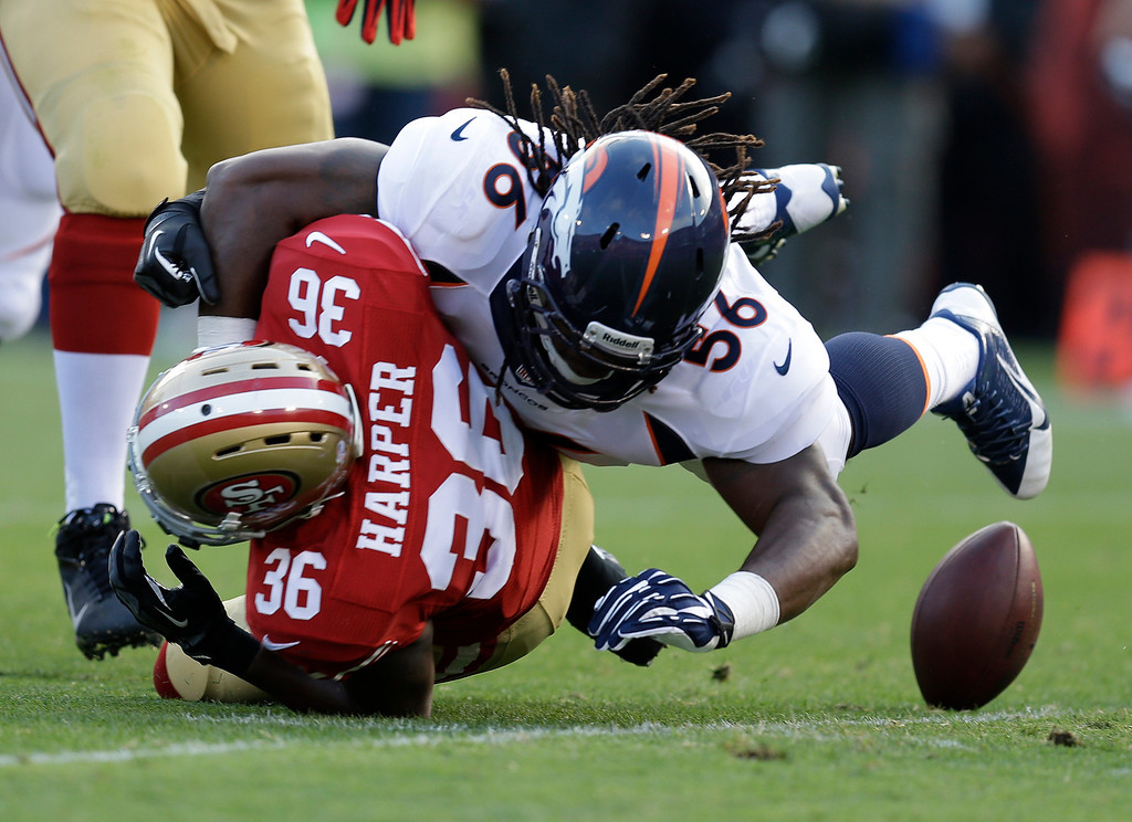 . San Francisco 49ers running back D.J. Harper (36) fumbles the ball while being hit by Denver Broncos linebacker Nate Irving, right, during the second quarter of an NFL preseason football game on Thursday, Aug. 8, 2013, in San Francisco. Broncos\' Shaun Phillips recovered the ball for a touchdown. (AP Photo/Ben Margot)