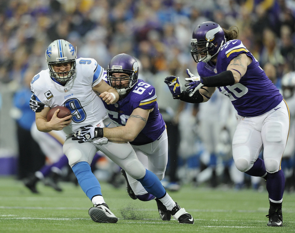 . Matthew Stafford #9 of the Detroit Lions is sacked by Jared Allen #69 of the Minnesota Vikings as teammate Brian Robison #96 looks on during the first quarter of the game on December 29, 2013 at Mall of America Field at the Hubert H. Humphrey Metrodome in Minneapolis, Minnesota. (Photo by Hannah Foslien/Getty Images)