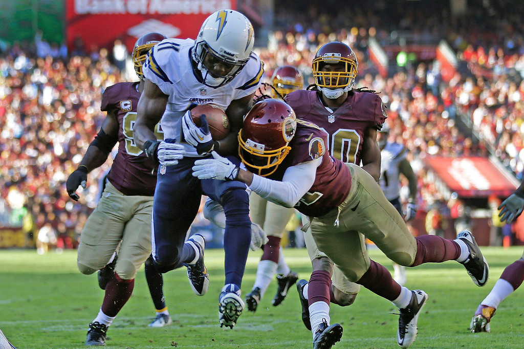. San Diego Chargers wide receiver Eddie Royal breaks a tackle from Washington Redskins strong safety Brandon Meriweather to score a touchdown during the first half of a NFL football game in Landover, Md., Sunday, Nov. 3, 2013. (AP Photo/Patrick Semansky)
