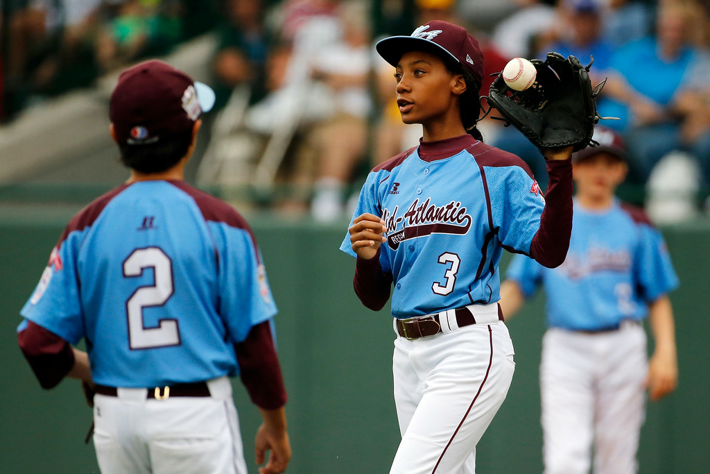 . Pennsylvania pitcher Mo\'ne Davis (3) gets the ball back from third baseman Jack Rice (2) during the fifth inning of a 4-0 shutout against Tennessee during a baseball game in U.S. pool play at the Little League World Series tournament in South Williamsport, Pa., Friday, Aug. 15, 2014. (AP Photo/Gene J. Puskar)
