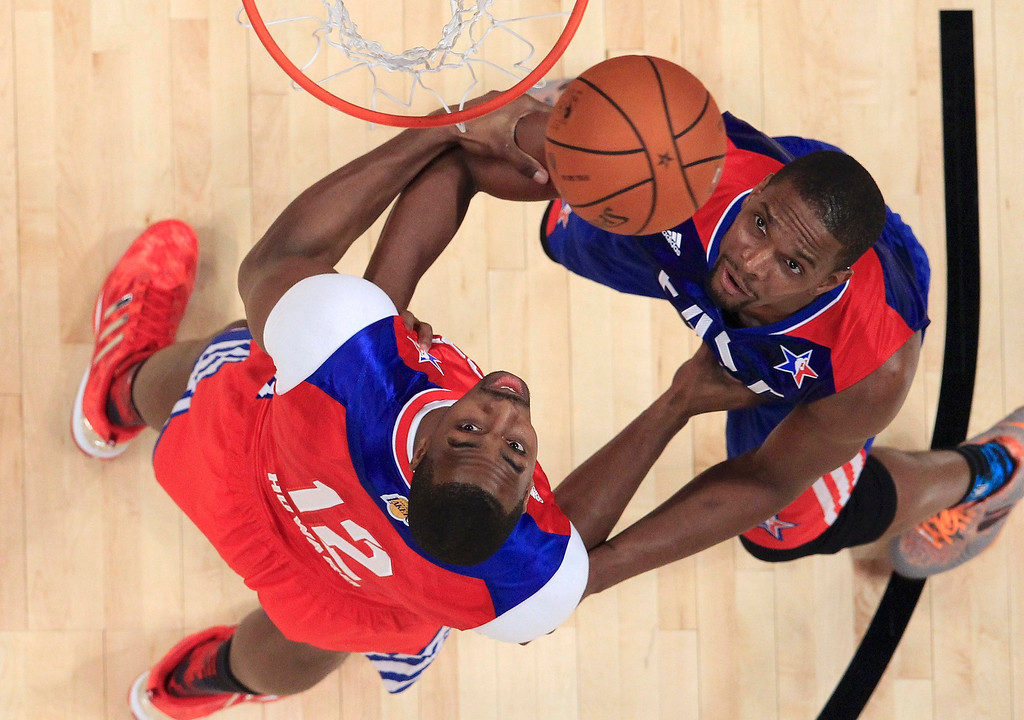 . NBA All-Star Dwight Howard of the Los Angeles Lakers (L) and Chris Bosh of the Miami Heat (R) look for a rebound in the second half during the 2013 NBA All-Star basketball game in Houston, Texas, February 17, 2013.  REUTERS/Lucy Nicholson (UNITED STATES  - Tags: SPORT BASKETBALL)