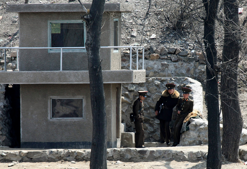 . In this Monday, April 15, 2013 photo, North Korean soldiers stand outside their watch house on the river bank of the North Korean town of Sinuiju, opposite the Chinese border city of Dandong.  After a day of festivities to mark the 101st birthday of its first leader, North Korea on Tuesday offered new prickly rhetoric against the United States and South Korea, which are watching closely for signs whether it will conduct a medium-range missile test in defiance of international concerns. (AP Photo)