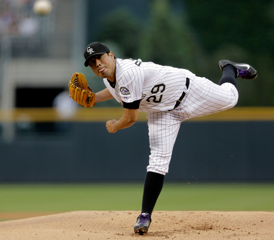 . Colorado Rockies starting pitcher Jorge De La Rosa throws in the first inning of a baseball game against the Washington Nationals on Wednesday, June 12, 2013, in Denver. (AP Photo/Joe Mahoney)