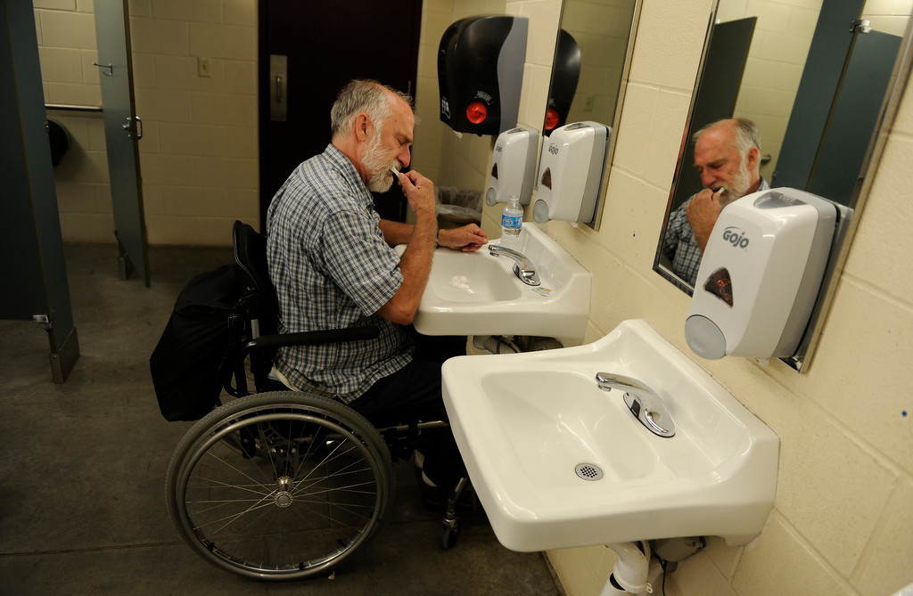 . High Park fire evacuee Jim Conklin, brushes his teeth in the bathroom at the Red Cross Shelter at The Ranch in Loveland, Tuesday, June 12, 2012. Conklin, who\'s home is in Rist Canyon area, has been staying in the shelter since Saturday. RJ Sangosti, The Denver Post