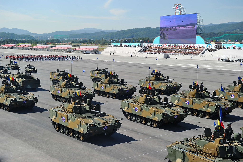. K-21 infantry fighting vehicles from South Korean army parade at Seoul Air Base during the 65th anniversary of the Republic of Korea armed Forces day on September 27, 2013.  This year\'s event opened with the largest scale of military with eleven thousand of troops, some 190 armed vehicles and about 120 military aircrafts.   KIM DOO-HO/AFP/Getty Images