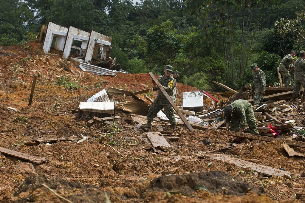 . Mexican soldiers work on the site of a landslide in La Pintada, state of Guerrero, Mexico, on September 19, 2013 as heavy rains hit the country.  AFP PHOTO/RONALDO  Schemidt/AFP/Getty Images