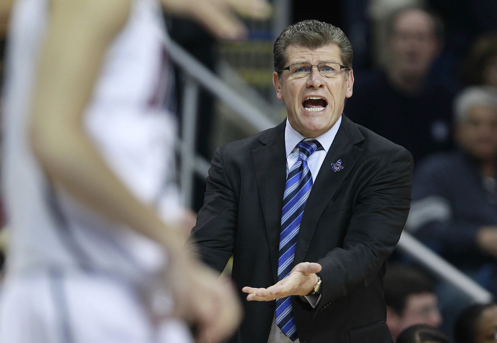 . Connecticut head coach Geno Auriemma calls to his players in the first half of a women\'s NCAA regional final basketball game against Kentucky in Bridgeport, Conn., Monday, April 1, 2013. (AP Photo/Charles Krupa)
