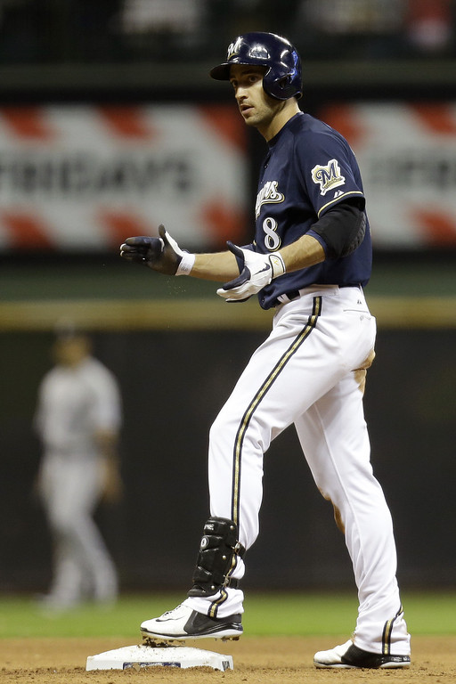 . MILWAUKEE, WI - APRIL 3:  Ryan Braun #8 of the Milwaukee Brewers celebrates after hitting a double, scoring Rickie Weeks in the bottom of the seventh inning against the Colorado Rockies at Miller Park on April 3, 2013 in Milwaukee, Wisconsin. (Photo by Mike McGinnis/Getty Images)