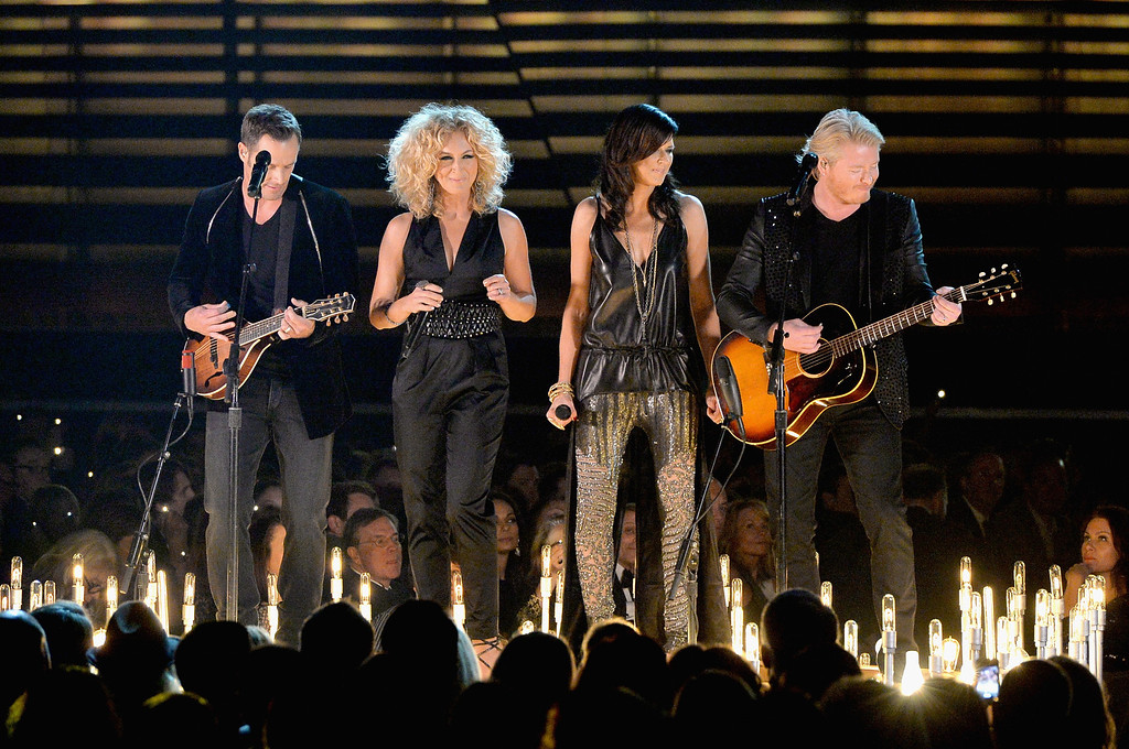 . NASHVILLE, TN - NOVEMBER 06:  Little Big Town performs onstage during the 47th annual CMA Awards at the Bridgestone Arena on November 6, 2013 in Nashville, Tennessee.  (Photo by Rick Diamond/Getty Images)