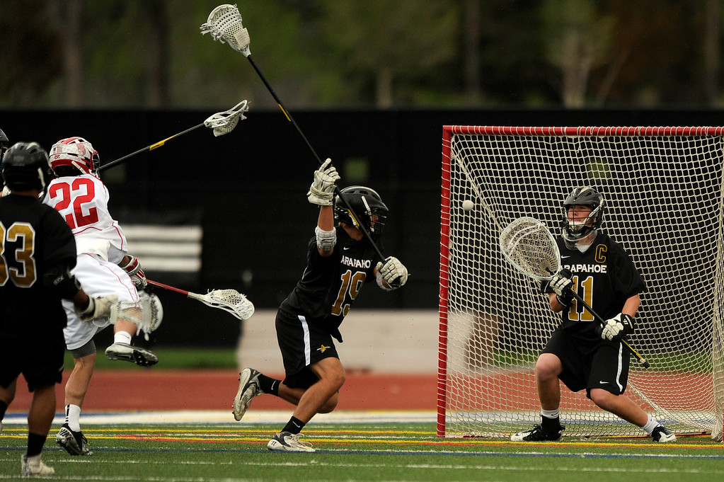 . DENVER, CO - MAY 15: Arapahoe senior goalie Ryan Smith #11 makes a save against Regis Jesuit during a CHSAA 5A boys lacrosse semifinal game on May 15, 2013, in Denver, Colorado. Arapahoe won 13-5 to advance to the finals. (Photo by Daniel Petty/The Denver Post)