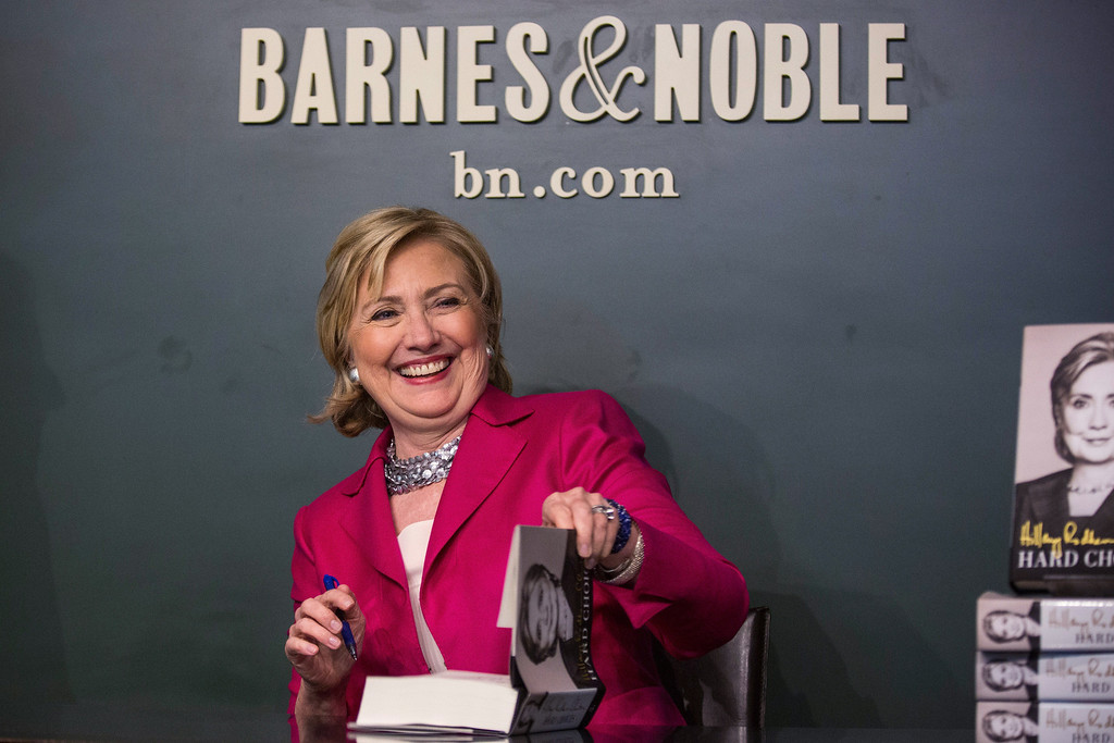 """. Former Secretary of State Hillary Clinton poses with her new book, \""""Hard Choices\"""" during a book signing at a Barnes & Noble on June 10, 2014 in New York City.   (Photo by Andrew Burton/Getty Images)"""