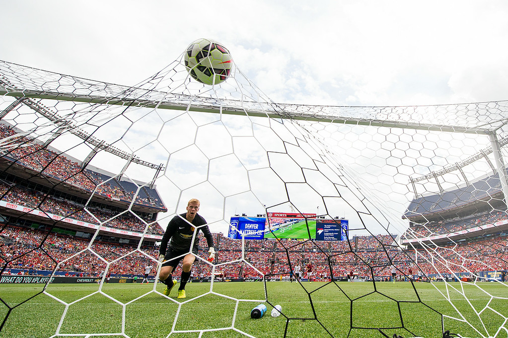 . Manchester United goalkeeper Ben Amos #40 looks on as a ball shot by AS Roma\'s Miralem Pjanic lands over his head during an exhibition match of the Guinness International Champions Cup at Sports Authority Field at Mile High on July 26, 2014, in Denver, Colorado. United won 3-2. (Photo by Daniel Petty/The Denver Post)