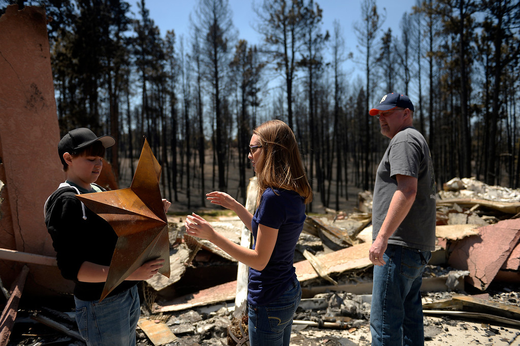 . COLORADO SPRINGS, CO. - June 19: Nolan Schultz 16 and his sister Annissa 20, with a surviving ornament that their dad Mike pulled from his families home of 8 years. Nolan had not seen the damage and was very affected by the loss. More residents were allowed back to see their homes that were burned in the Black Forest Fire area near Colorado Springs, Colorado. June 19, 2013 Colorado Springs. (Photo By Joe Amon/The Denver Post)