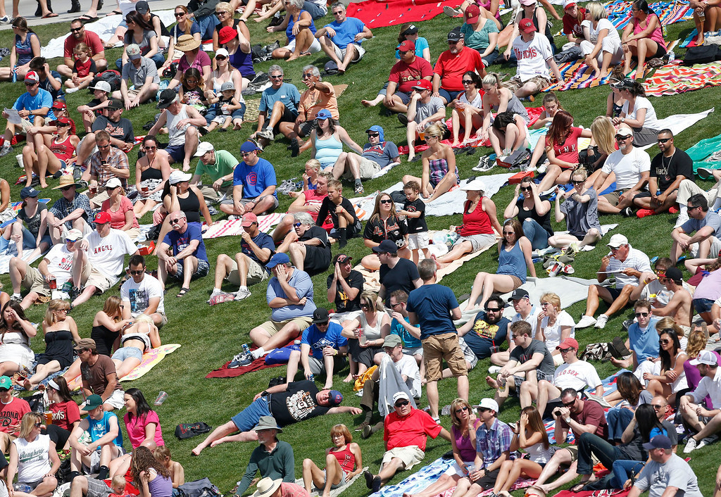 . Fans sit in right field during the Cleveland Indians and Arizona Diamondbacks spring training baseball game, Thursday, March 21, 2013, in Scottsdale, Ariz. (AP Photo/Matt York)