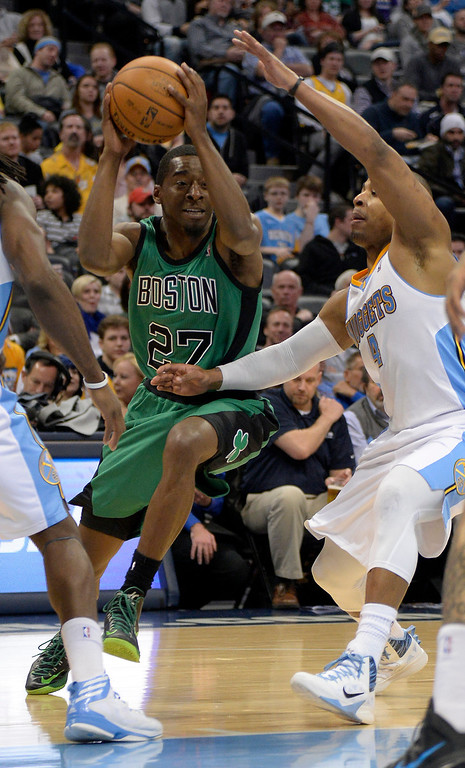 . Boston Celtics shooting guard Jordan Crawford (27) drives on Denver Nuggets shooting guard Randy Foye (4) during the third quarter January 7, 2014 at Pepsi Center. (Photo by John Leyba/The Denver Post)