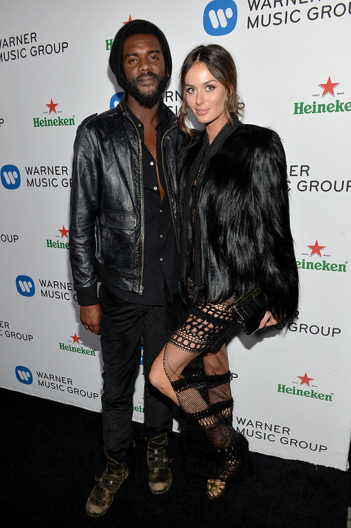 . Recording artist Gary Clark Jr. (L) and model Nicole Trunfio attend the Warner Music Group annual GRAMMY celebration on January 26, 2014 in Los Angeles, California.  (Photo by Michael Buckner/Getty Images for Warner Bros.)